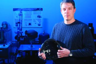 This employee works on helmet technology as a project engineer at AMC's Natick Soldier Research, Development and Engineering Center. Research into traumatic brain injury, or TBI, has brought together the military, the sports industry, and academia. Photo by Jon Connor, ASC Public Affairs