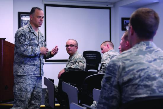 Air Force Special Operations Command Command Chief Master Sgt. Matthew Caruso speaks to a group of airmen at an open forum during his tour of the Airman Leadership School June 12, 2014, at Cannon Air Force Base, New Mexico. Caruso made a point to interact with as many Cannon Air Commandos as possible during his visit. U.S. Air Force photo/Airman 1st Class Chip Slack