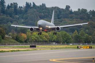 The Boeing-built KC-46A Pegasus tanker lands after its first flight, from Paine Field, Everett, Washington, to Boeing Field, Seattle. Sept. 25, 2015. Boeing photo