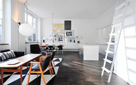 suelo oscuro parquet roble sillas hormiga piso decoración estocolmo iconos diseño nórdico grandes ventanales arquitectura y decoración estilo sueco