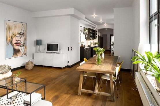 sillas Serie 7 de Fritz Hansen sillas Eames DAX de Vitra muebles de diseño estilo nórdico decoración de salones decoración de comedores cocinas nórdicas negro y blanco cocinas modernas negras cocinas alargadas rectangulares