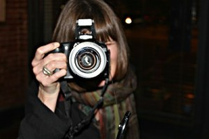 Jill Coursin doing what she loves to do - take photographs. Photo by Delta Bohemian