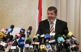 egypt mursi at podium with microphones