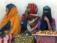 Somalia women in traditional dress on chairs