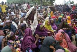 Attack Expected in Kenya Somalis who fled from southern Somalia, wait to receive food at a camp in Mogadishu, Somalia, Wednesday, July 13, 2011, ahead of a distribution by a local NGO. Thousands of people have arrived in Mogadishu over the past two weeks seeking assistance and the number is increasing by the day, due to lack of water and food. The drought in the Horn of Africa has sparked a severe food crisis and high malnutrition rates. (AP Photo/Mohamed Sheikh Nor)