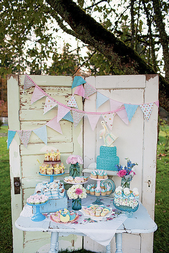 vintage stork themed baby shower dessert table setup