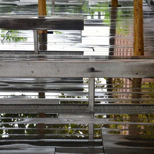Enjoying reflections in the rain water on the Highline