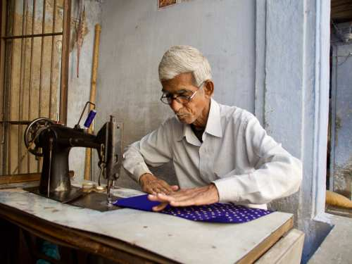 sewing on the streets of Ahmedabad