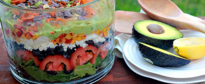 7 Layer Salad with Avocado Lemon Crema Dressing