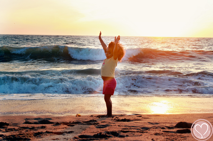 biracial girl at the beach in california