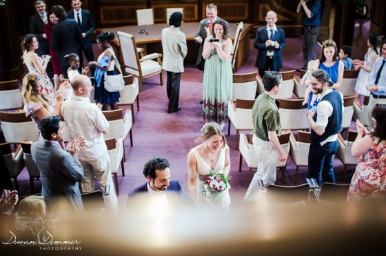 London Wedding Photography of Husband and Wife walk down the Aisle at the Stoke Newington Town Hall