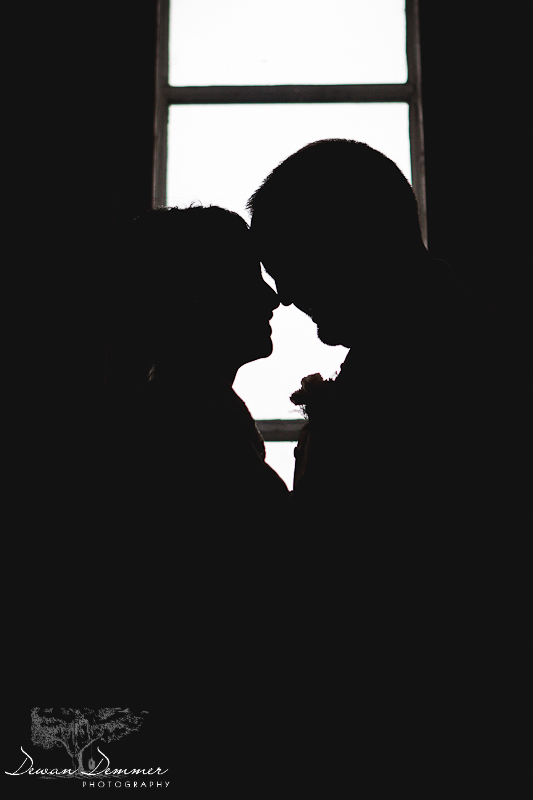 Bride and Groom silhoutte by window