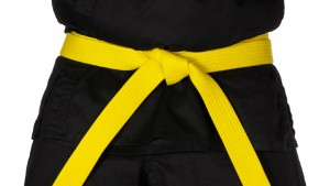 Karate Yellow Belt Tied Around Torso Black Uniform