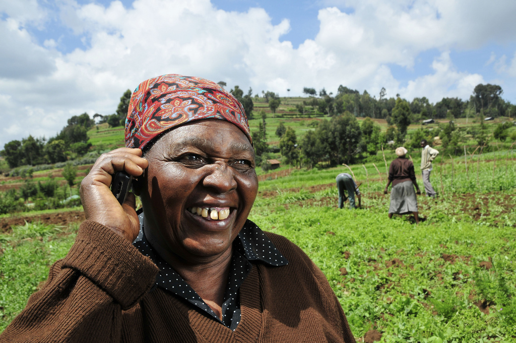 African-Farmer-Cell-Phone-by-Neil-Palmer-CIAT.jpg