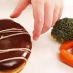 kid-reaching-for-donut-willpower-article