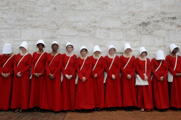 "Women dressed as handmaids promoting the Hulu original series ""The Handmaid's Tale"" stand along a public street during the South by Southwest (SXSW) Music Film Interactive Festival 2017 in Austin, Texas, U.S., March 11, 2017. REUTERS/Brian Snyder - RTX30ML9"
