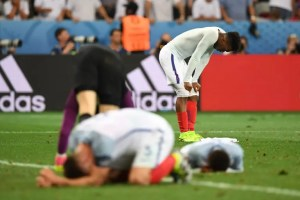 England's forward Daniel Sturridge (back) and England's defender Gary Cahill reacts after loosing 1-2 to Iceland in the Euro 2016 round of 16 football match between England and Iceland at the Allianz Riviera stadium in Nice on June 27, 2016.   / AFP PHOTO / PAUL ELLIS