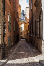 Colorful houses line tiny streets in Stockholm's Old Town. July 2015.