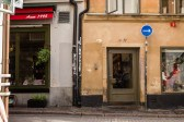 Storefronts in Gamla Stan project an old world feeling. July 2015.