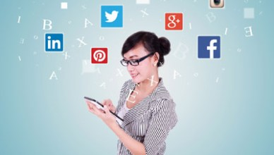 45146642 - jakarta, september 08, 2015: image of young asian woman holding and using digital tablet with social media icons: facebook, google plus, instagram, twitter, pinterest, and linkedin