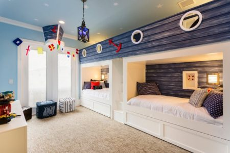 cute beach inspired shared kids bedroom design with a cozy carpet 775x517
