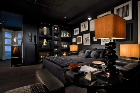 all black bedroom with an interesting art wall and very thoughtful lighting 775x557