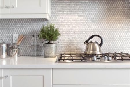 23 mother of pearl penny tile backsplash will reflect the light