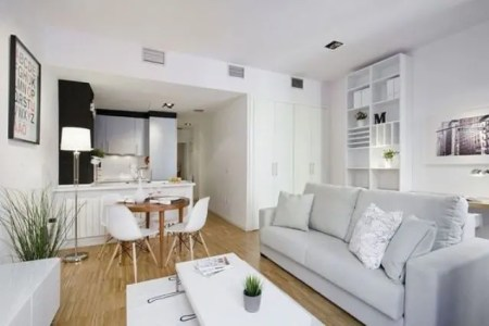 20 small space uniting a kitchen a diner and a living room all decorated in modern style and off whites