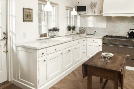 clic framed white kitchen with marble
