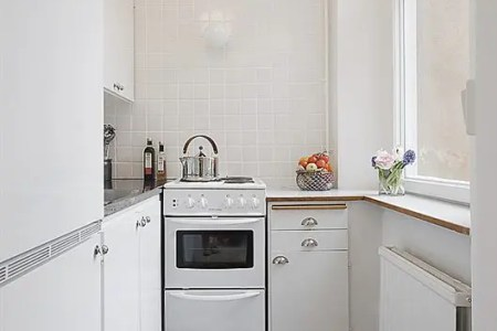 clean white small apartment interior design 11