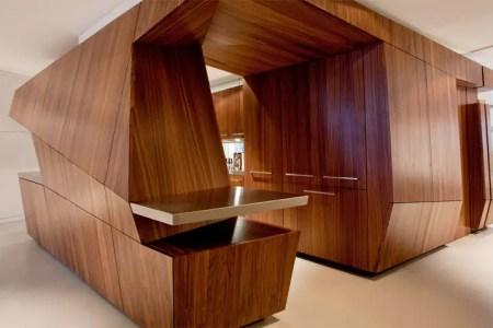 modern loft with a freestanding centralized wood veneer kitchen 4