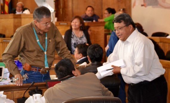 (L-R) Navajo Nation Council Delegates Kenneth Maryboy, Alton Shepherd, who is sitting, and Edmund Yazzie visit during a brief recess of the Council's Feb. 21, 2014, special session on capital improvement projects. The Council met in the Council chamber in Window Rock, Ariz. Photo by Marley Shebala