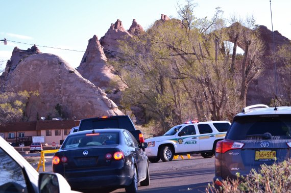 Navajo Nation police dismantled their early morning blockade of the road entrance to the Navajo Council chamber and Office of the President and Vice President on April 21, 2014, after information about an anti-uranium demonstration proved to be wrong. In the background is the Window Rock rock formation. Photo by Marley Shebala.