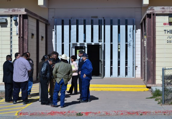 Navajo Council delegates, legislative staff and other individuals talk briefly outside the Navajo Nation Window Rock District Court on after an April 8, 2014, hearing on a Temporary Restraining Order filed by Speaker Naize against 12 delegates and one legislative employee. Photo by Marley Shebala.