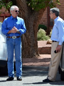 URI President/Chief Executive Officer Christopher M. Jones and URI Vice President for Health , Safety, Environment & Public Affairs Mark S. Pelizza chat outside the Navajo Council chamber after the Resources & Development Committee removed proposed legislation to dissolve RDC subcommittee that's negotiating with URI on May 27, 2014. Photo by Marley Shebala.