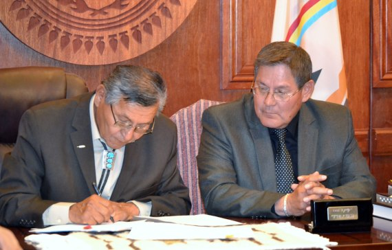 (l-R) Navajo Nation President Ben Shelly and Speaker Pro Temp LoRenzo Bates held a signing ceremony for a $554 million settlement of a lawsuit against the U.S. at the executive offices in Window Rock, Ariz., on June 4, 2014. Photo by Marley Shebala.