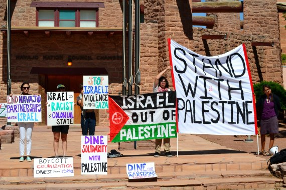 A group of young Navajo people demonstrate against the Israelies horrific bombing of Palestine and President Ben Shelly's financial relationship with Israel in front of the Navajo Council chambers in Window Rock, Ariz., on July 17, 2014. Photo by Marley Shebala. (Please provide proper photo credit when reusing photo.)