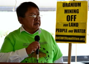 A neon green  tee shirt was part of the 35th commemoration of a 1979 radioactive flood near Church Rock, N.M., Navajo Council Delegate Mel Begay was among several tribal dignataries at the commemoration on July 19, 2014. Photo by Marley Shebala. (Please provide proper photo credit when reusing photo.)