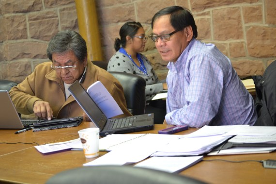 Navajo Council's Law and Order Committee member/Council Delegate Russell Begaye and Council Delegate Lorenzo Curley chat before LOC defer's Curley's legislation to amend Navajo Election Code regarding Navajo language fluency requirement for presidential candidates on Nov. 17, 2014, in the north conference room of the Navajo Council chambers in Window Rock, Ariz. (Photo by Marley Shebala. Provide proper credit when reusing photo.)
