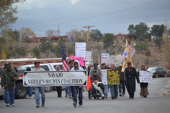 The Navajo Voters Rights Coalition protesting the failure of an over-ride of a presidential veto by the Navajo Nation Council on Nov. 13, 2014. The coalition marched from the Window Rock, Ariz., Mini-Mall to the Council chambers, Office of President and Vice President and back to the front of the Council chambers in Window Rock, Ariz., on Nov. 13, 2014. (Photo by Marley Shebala. If reusing, please provide proper photo credit.)