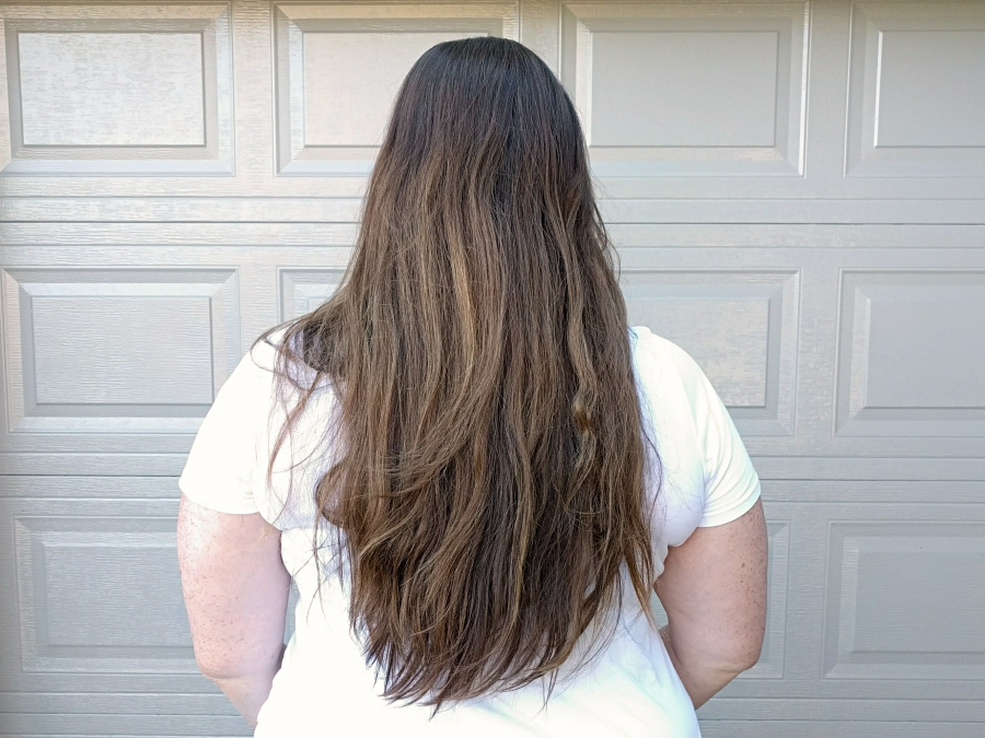 Before photo of hair. Down to waist with grown our colour and demarcation line.