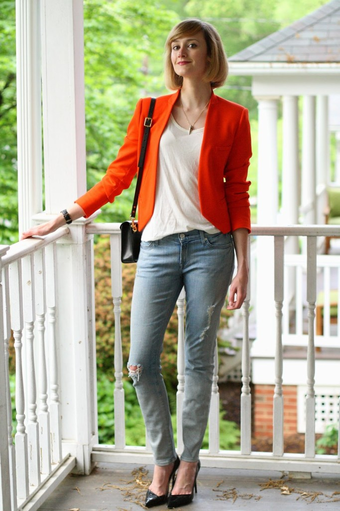orange blazer and distressed denim
