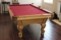 Wine colored cloth installed on this Olhausen pool table.
