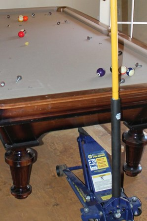 Here is an 1100 pound pool table that was improperly moved and two legs were broken.