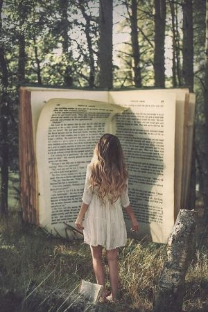 girl reading big book