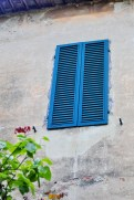 Blue Italian shutters.
