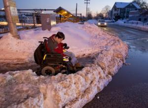 Christopher Hart of Hyde Park found his way blocked by a wall of snow Thursday. (Matthew J. Lee/ Globe Staff)