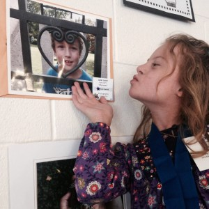 Juliet & her winning photograph of her brother in the school's art contest