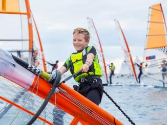 Learn windsurfing at the Brighton and Seacliff Yacht Club this summer.
