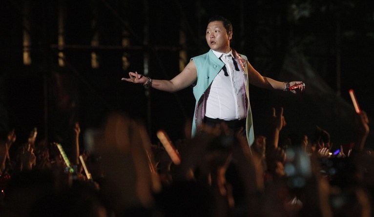 Singer Psy performs at the Seoul Plaza in front of Seoul city hall
